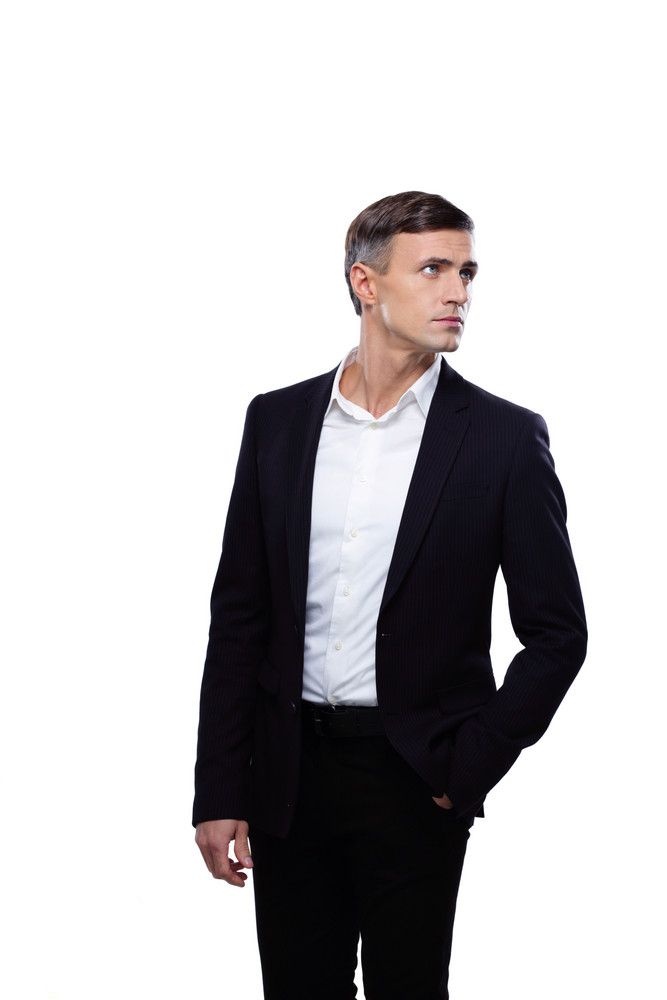 Young confident businessman looking away over white background