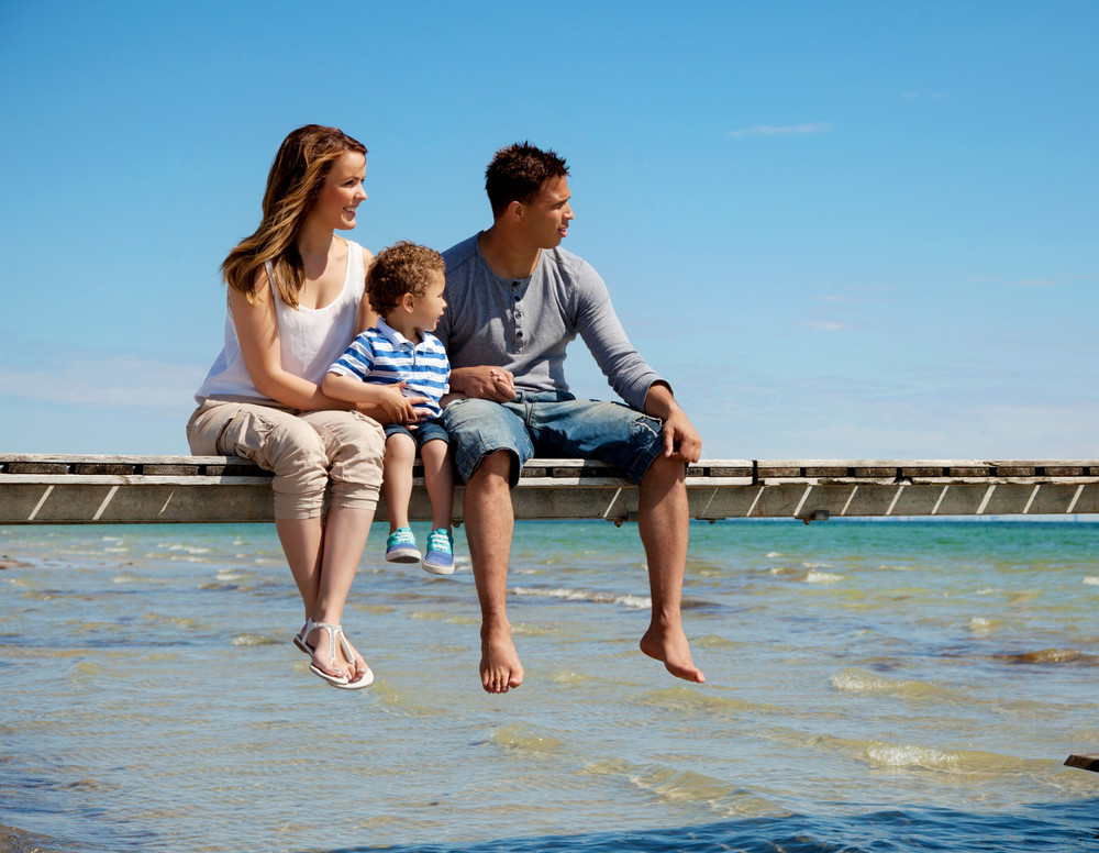 Young family enjoys the beautiful view of the beach