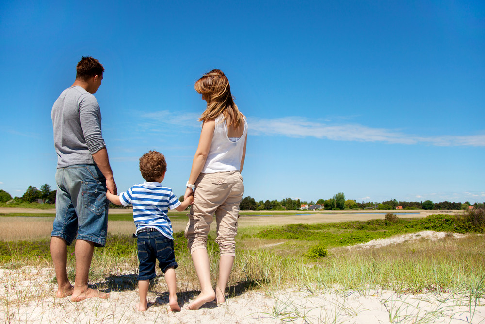 Young family looking and enjoying the beautiful landscape