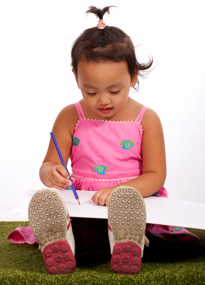 Young Girl Drawing On Sketch Paper
