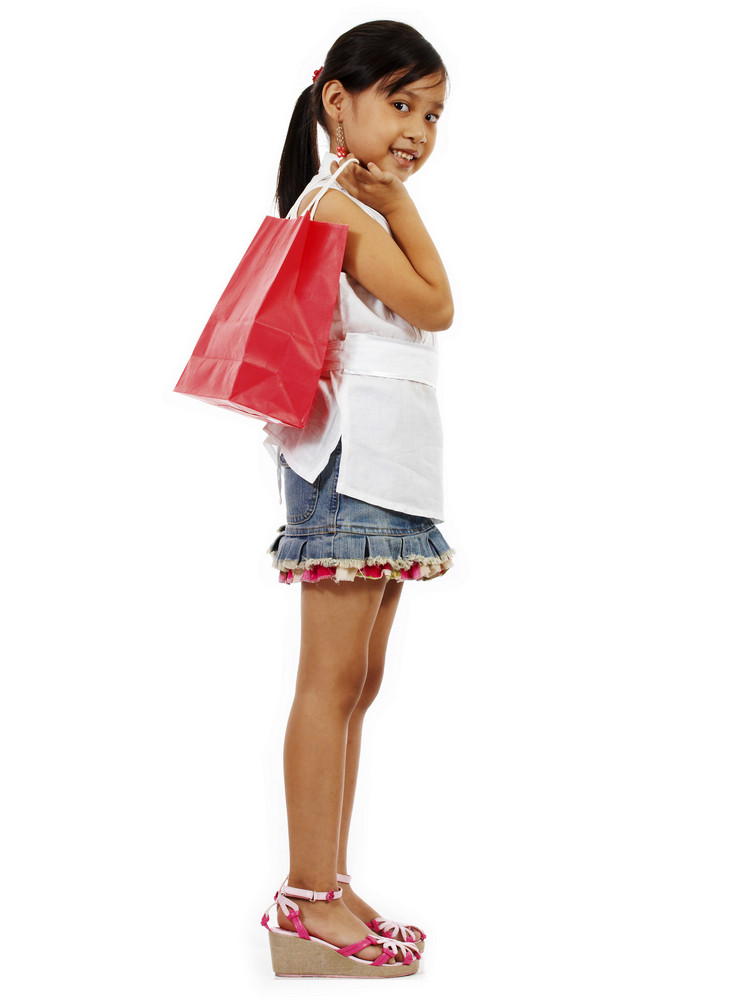 Young Girl Holding A Shopping Bag