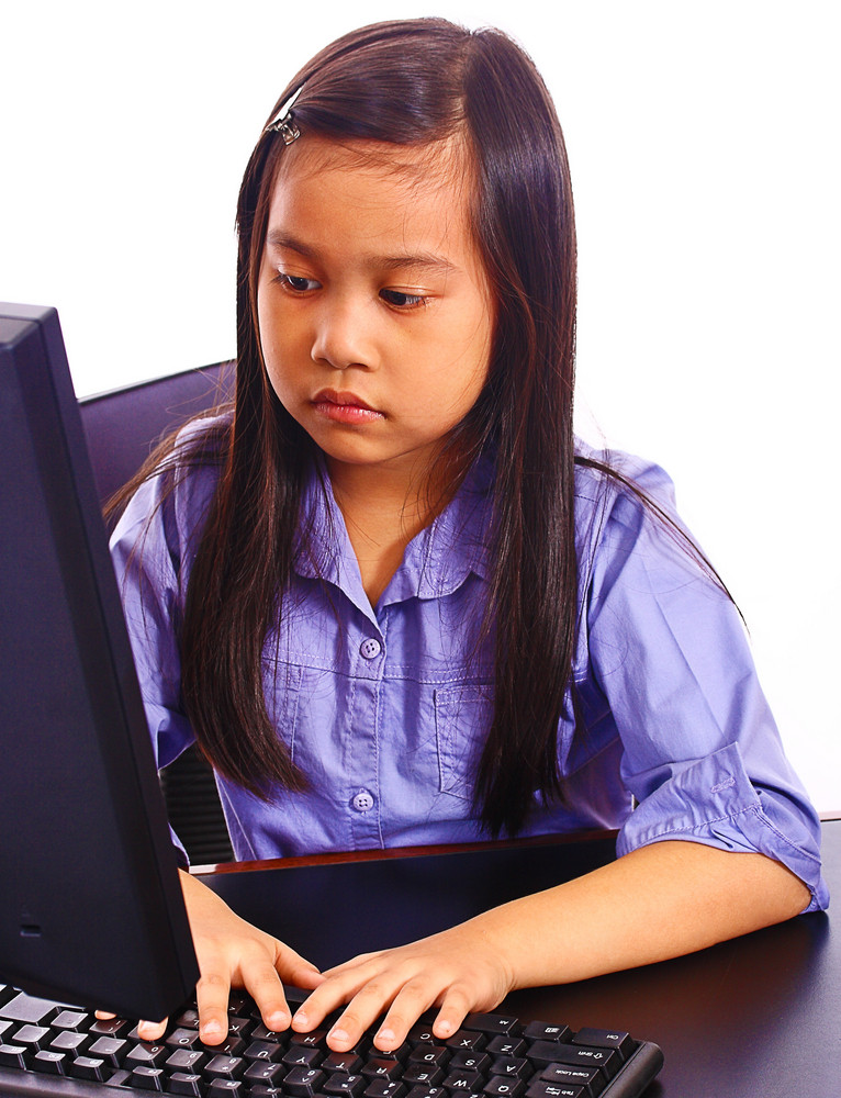 Young Girl Studying And Browsing The Internet