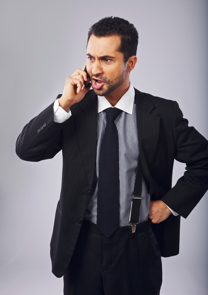 Young professional angry with someone over the phone