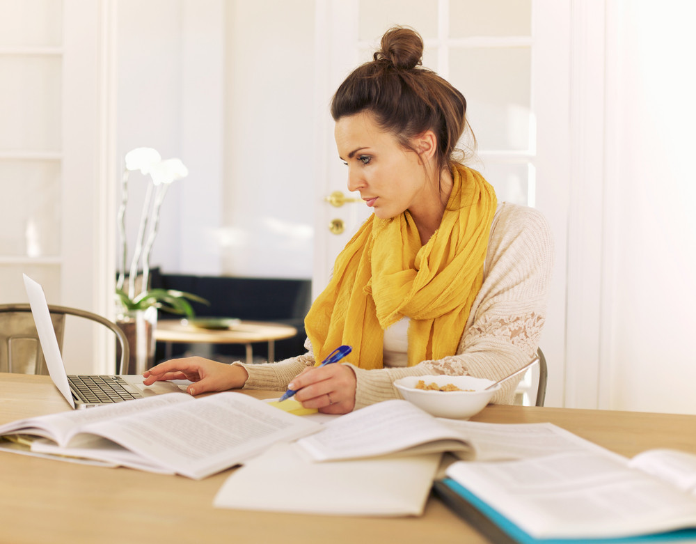 Young University Student Busy with Studying