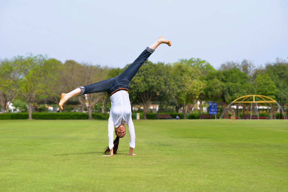 Young Woman Jumping In Park