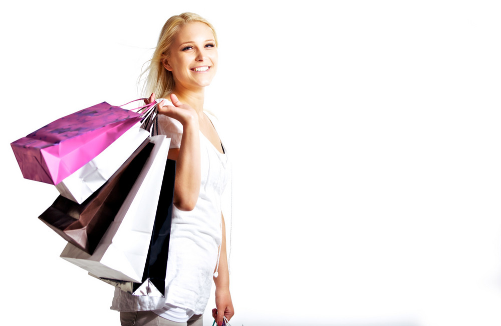Young woman shopping isolated on white background