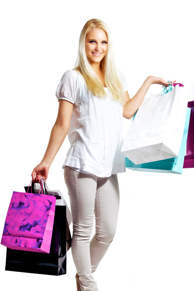 Young Woman Shopping With Shopping Bags In Hands