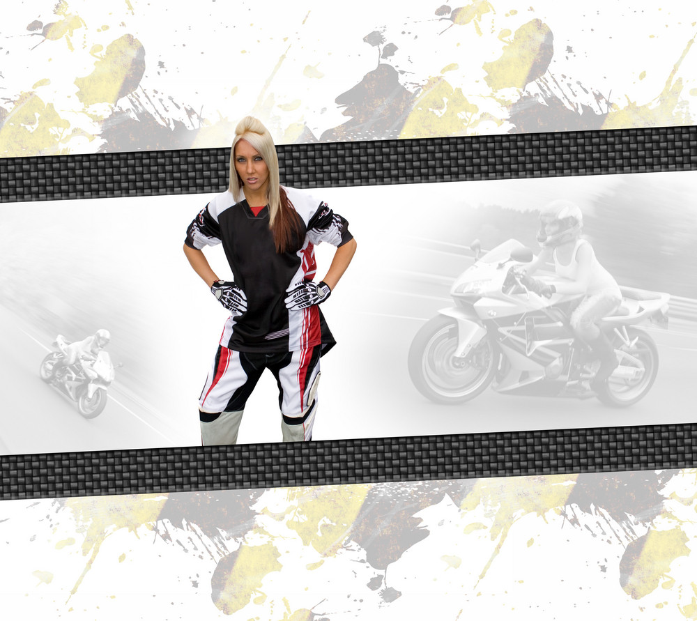 Young woman wearing a motorcycle racing suit in a layout with copyspace.