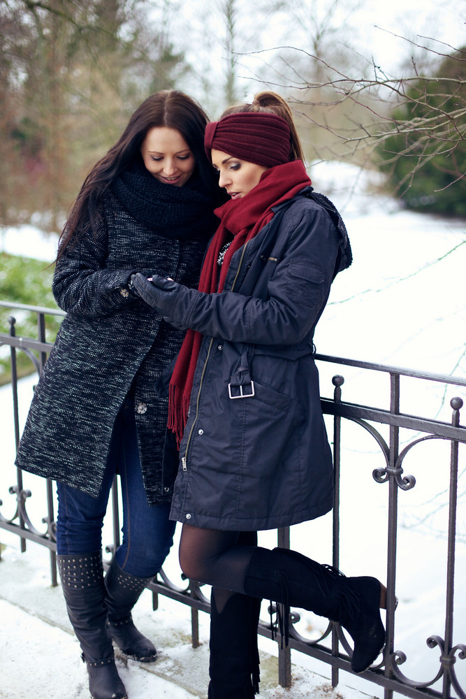 Young Women at Winter Park Looking at Something