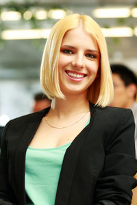 Portrait of a young smiling businesswoman in office