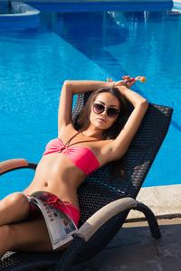 Girl lying on deckchair with lollipop