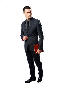 Businessman standing and holding tablet computer isolated on a white background