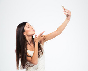 Woman making selfie photo