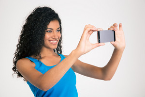 Smiling afro american woman making selfie photo