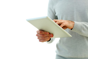 Closeup image of male hand touching display of tablet computer isolated on a white background