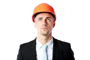 Portrait of a pensive businessman in orange helmet isolated on a white background