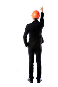 Back view portrait of a businessman in protective helmet directing works over white background