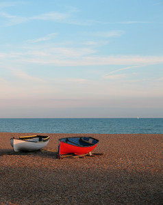 2 Wooden Boats On A Stone Beach In Brighton Uk. Nice Summer Evening.