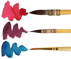 3 Brushes With Different Colours Of Paint