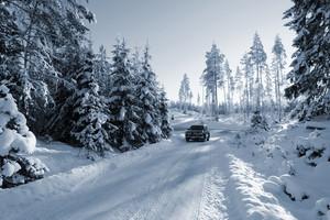 4x4, car driving in rough snowy terrain