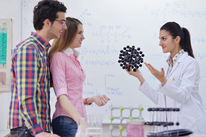 Happy group of teens in school