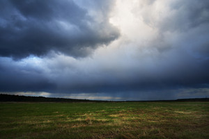 Dark Dramatic Rain Clouds Over Countryside Landscape. Autumn In Latvia.