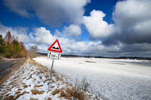 Old Automobile Road In Countryside Area And Warning Sign In Winter.