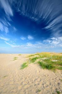 Baltic Sea Shore Sandy Beach Against Blue Sky