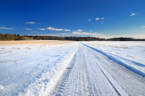 Classic Winter Scene Of A Road In Rural Area