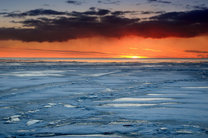 Colorful Sunset At The Snowy Baltic Sea Shore