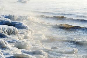 Frozen Sea View. Waves Hitting Icy Coastline