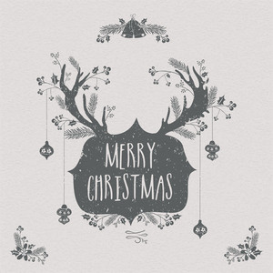 Creative greeting card design with reindeer horns and other ornaments for Merry Christmas celebration.