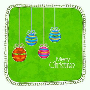 Beautiful greeting card design with floral decorated colorful Xmas Balls for Merry Christmas celebration.