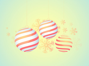 Creative hanging Xmas Balls on snowflakes decorated glossy background for Merry Christmas celebration.