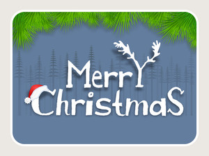 Creative text Merry Christmas on fir trees decorated blue background.