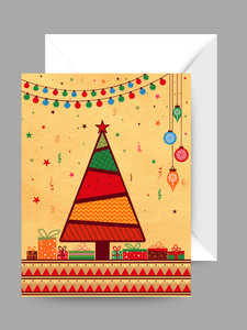Colorful ornaments decorated greeting card with envelope for Merry Christmas celebration.