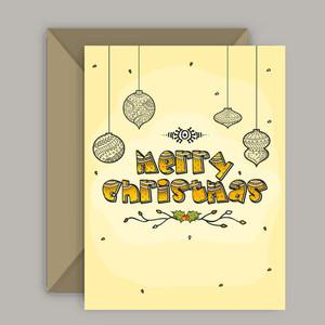 Elegant greeting card design with envelope for Merry Christmas celebration.
