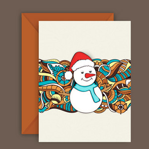Cute snowman and floral design decorated greeting card with envelope for Merry Christmas celebration.