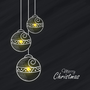Shiny Xmas Balls hanging on grey background for Merry Christmas celebration.