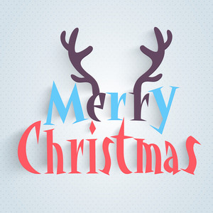 Stylish text Merry Christmas with reindeer horns on shiny background.