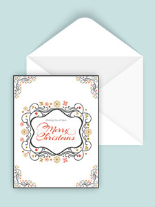 Beautiful floral design decorated greeting card with glossy envelope for Merry Christmas celebration.
