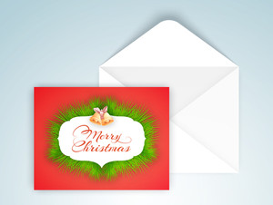 Elegant greeting card design with glossy envelope for Merry Christmas celebration.