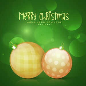 Creative glossy Xmas Balls on shiny green background for Merry Christmas and Happy New Year celebration.