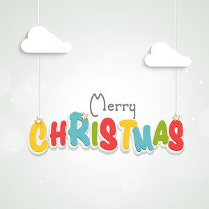 Colourful hanging text of Merry Christmas with silhouette of clouds on light sky blue backgrounds.