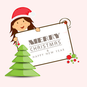 Little cute girl in Santa cap holding board for Merry Christmas and Happy New Year celebration with x-mas tree on beige background.