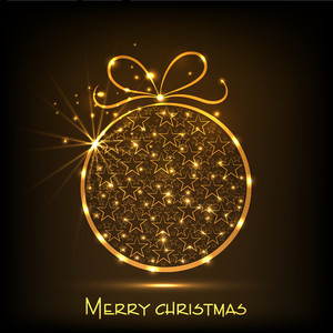 Shiny golden stars decorated Xmas ball for Merry Christmas celebration on brown background.