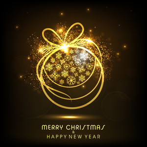 Merry Christmas and Happy New Year celebration with shiny golden christmas ball decorated by snowflake on brown background.