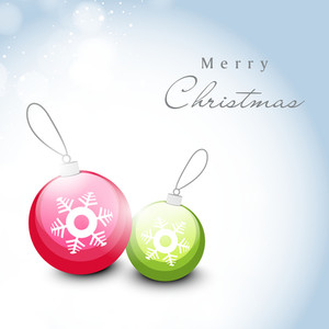 Merry Christmas celebration poster or greeting card deisgn with colorful shiny Xmas ball.
