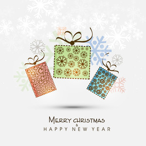 Floral decorated gifts box for Merry Christmas and Happy New Year celebration on snowflake decorated background.