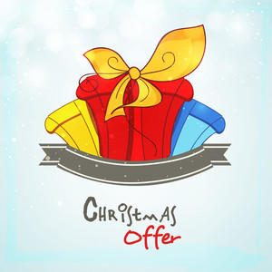 Christmas offer poster or banner with colorful gift boxes and blank ribbon on stylish sky blue background.